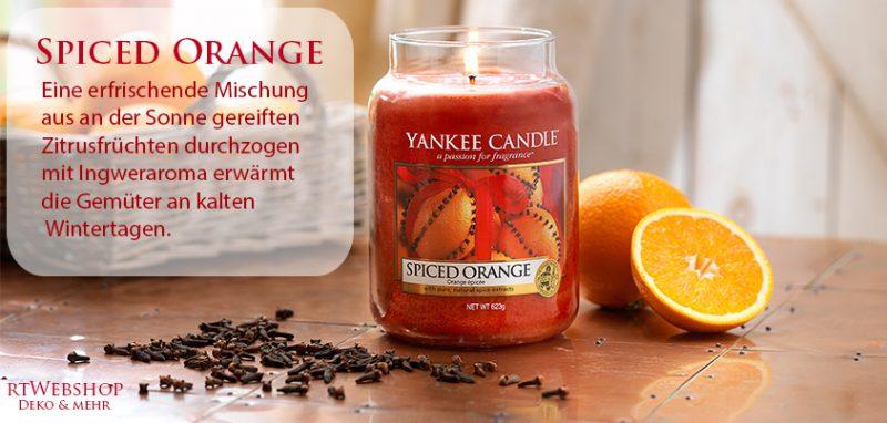 Yankee Candle Spiced Orange - eine erfrischende Mischung aus an der Sonne gereiften Zitrusfrüchten durchzogen mit Ingweraroma erwärmt die Gemüter an kalten Wintertagen.